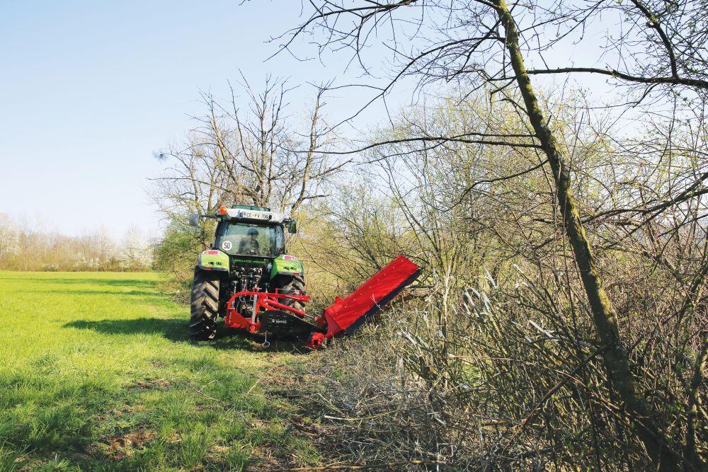 Side flail mowers for a bush