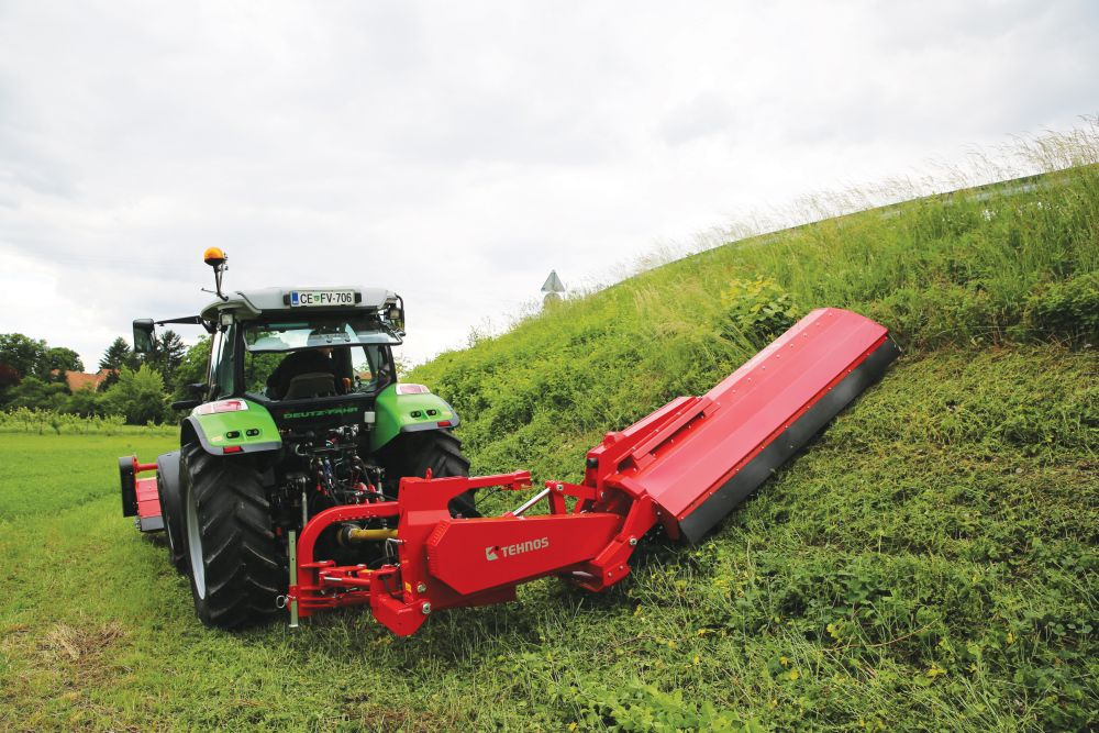 Side flail mowers for a grass
